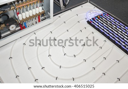 Modern floor heating system map with accessories. - stock photo