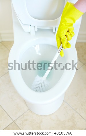 Modern flush toilet. Cleaning - stock photo