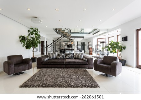 Modern front room with marble floor - stock photo