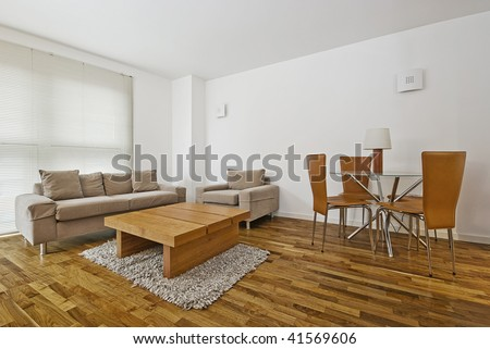 modern furnished living room and dining area - stock photo