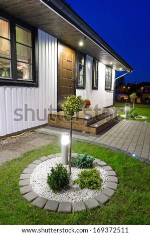 Modern garden entree to villa house - stock photo
