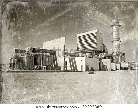 Modern Gas fired power plant made to look vintage depicting how today's modern technology is already antiquated. - stock photo