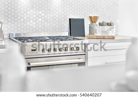 Modern Gas Stove Top View With Kitchen Utensils Beside Bee Shape Wall Tile,  Front Is