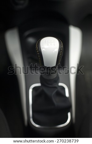 Modern gear shift lever in a luxury car,soft focus,close up - stock photo