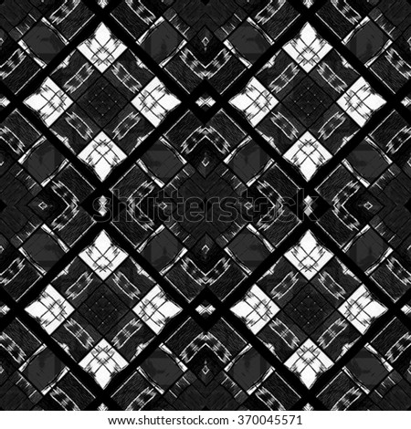 Modern geometric squares motif seamless pattern background mosaic in black and white tones.
