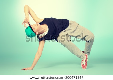 Modern girl dancer dancing in hip-hop style. Urban street style. - stock photo