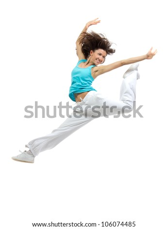 Modern girl dancer jumping and dancing hip-hop isolated on a white background