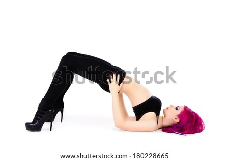 Modern girl dancer posing at studio. Isolated over white.