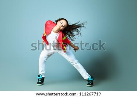 Modern girl dancing hip-hop at studio. - stock photo