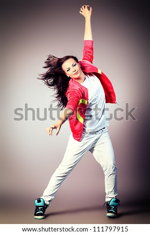 Modern girl dancing hip-hop at studio. - stock photo