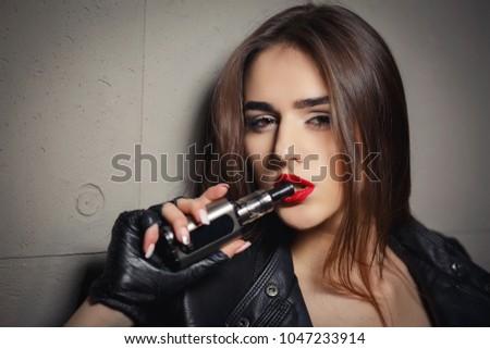 Smoking girls learning to inhale
