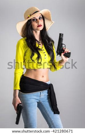 Modern girl with guns - stock photo