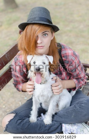 Modern girl with hat and her dog