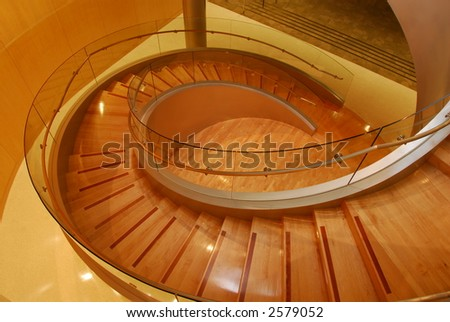 Modern glass an wooden spiral staircase - stock photo