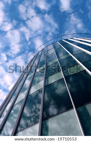 Modern glass architecture taken from below - stock photo