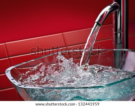 modern glass bathroom sink with running water and red tiles - stock photo