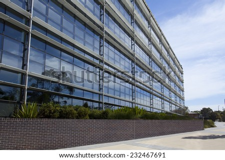 Modern glass building at Macquarie University - stock photo