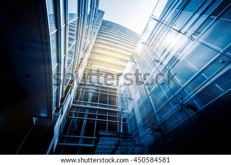 modern glass building,blue toned image