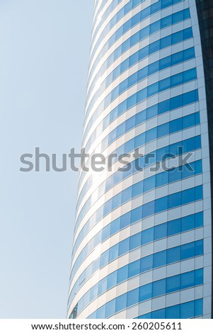 Modern glass building in the city with reflections - stock photo