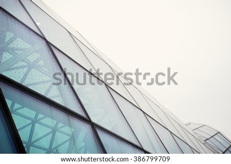 Modern glass building structure on white sky. Contemporary concept.