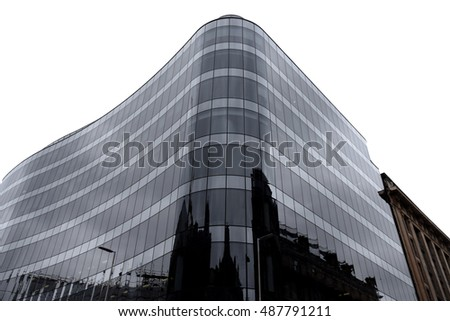 Modern glass curved building architecture reflecting city skyline