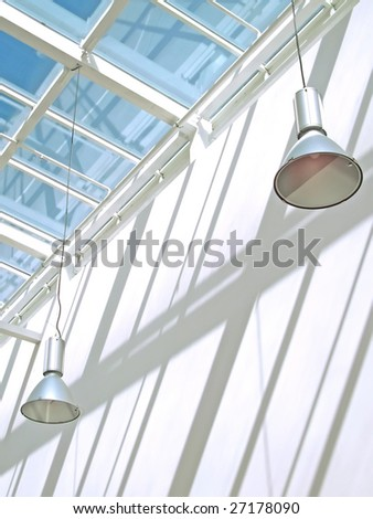 Modern glass roof and two electric lamp.