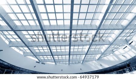 modern glass roof inside office center - stock photo