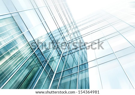 Modern glass silhouettes of building skyscrapers. Business concept of successful industrial architecture - stock photo
