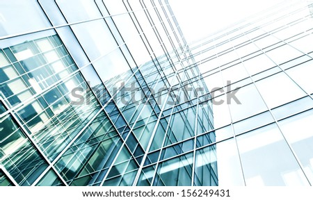 Modern glass silhouettes of building skyscrapers. Business concept of successful industrial architecture