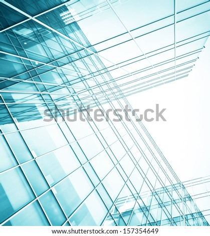 Modern glass silhouettes of building skyscrapers. Business concept of successful industrial architecture Business concept of successful industrial architecture