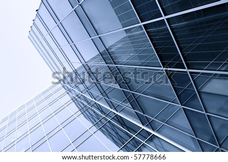 modern glass silhouettes of skyscrapers at night - stock photo