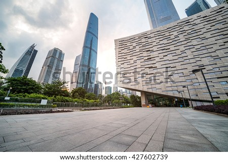Modern glass silhouettes of skyscrapers in the city - stock photo