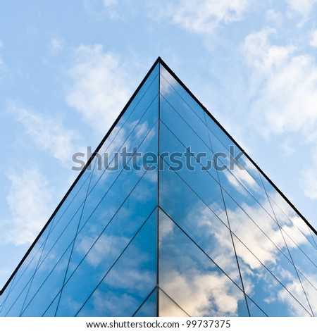 Modern glass silhouettes on modern building - stock photo