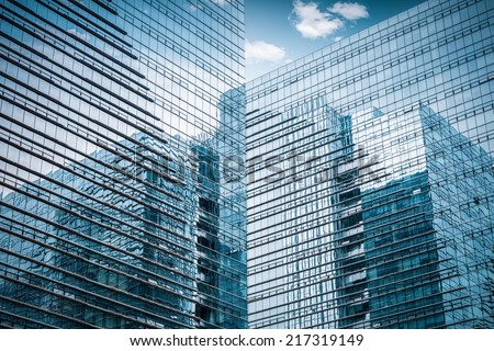 modern glass skyscraper closeup , sky with reflection of the abstract space  - stock photo