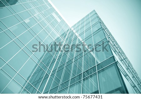 modern glass skyscraper perspective view - stock photo