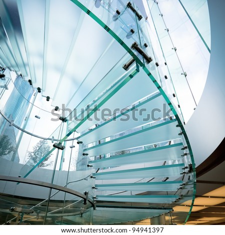 modern glass spiral staircase in shop - stock photo