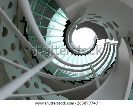 modern glass spiral staircase with metallic hand-rails. - stock photo