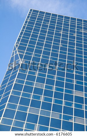 modern glass tower building reflecting blue sky - stock photo
