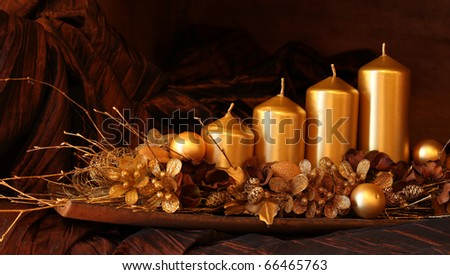 Modern gold advent decoration with four candles. Shallow dof - stock photo