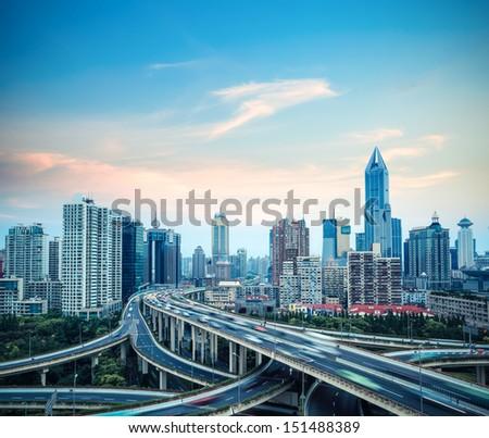 modern grade separation viaduct in shanghai at dusk,China - stock photo