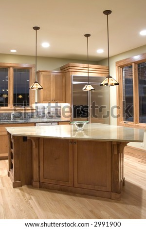 Modern granite and wood decor kitchen - stock photo