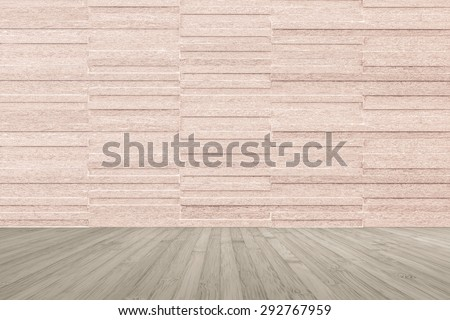 Modern granite tile wall pattern textured background in light red brown color with wooden floor in sepia brown color tone : Horizontal stone tile wall pattern texture with wood flooring           - stock photo