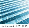 modern green glass skyscraper perspective view - stock photo