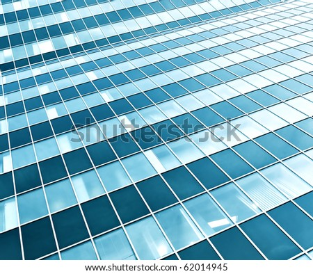 modern green glass skyscraper perspective view - stock photo