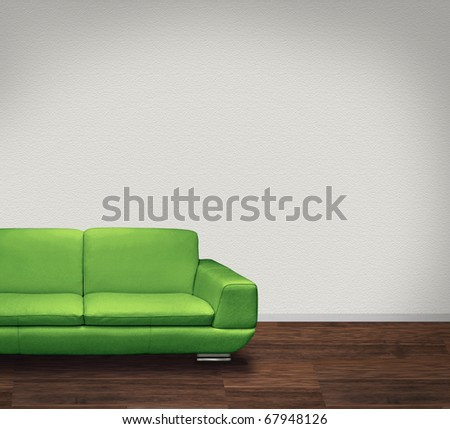Modern green leather sofa in room with dark floor and white walls - stock photo