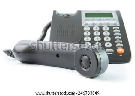 Modern grey color desk telephone isolated on white background - stock photo