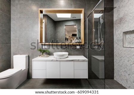 modern grey designer bathroom with herringbone shower tiling. Interior Design Ideas. Home Design Ideas