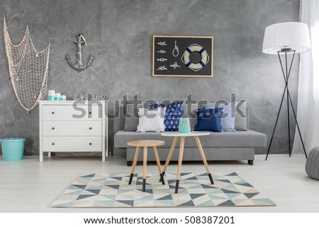 Modern Grey Living Room With Nautical Decorations And Decorative Wall Finish