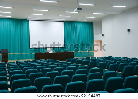 Modern hall for presentation with projection screen - stock photo