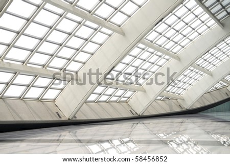 modern hall in beijing T3 airport with big windows - stock photo